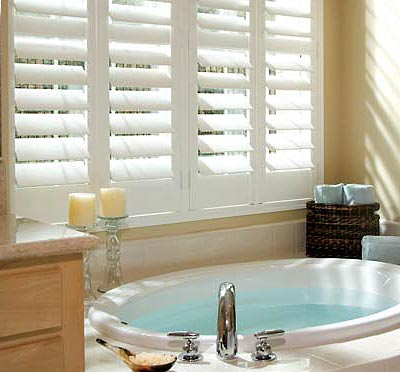 Image of a White Plantation Shutter in a bathroom