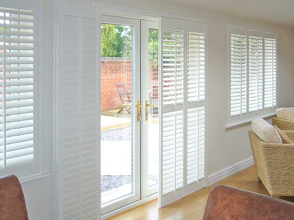 Image of a French Door with Bypass Track option allowing the plantation shutter door to slide open or closed.