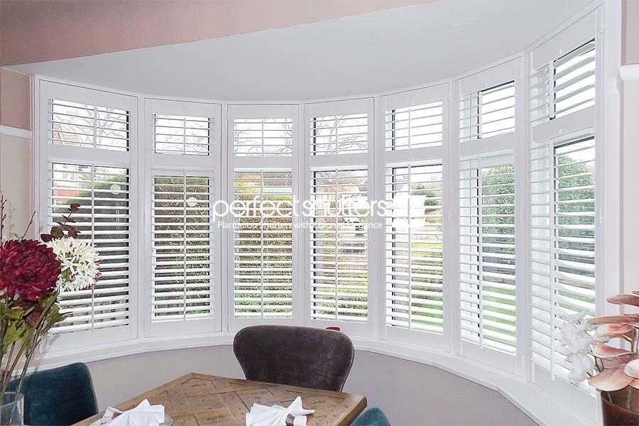 Bay window shutters in dining room