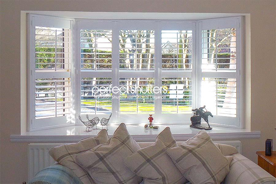 Bay window shutters in living room
