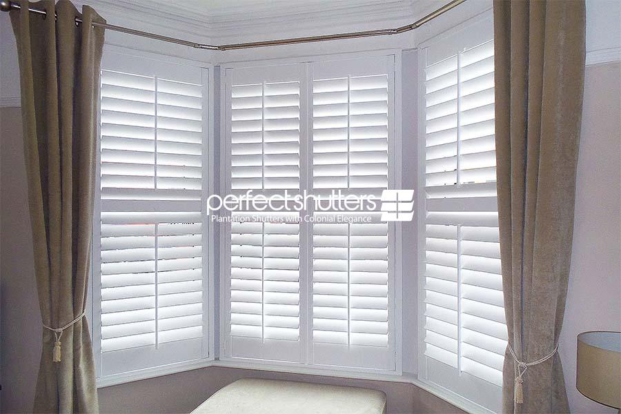 Bay window shutters with curtains