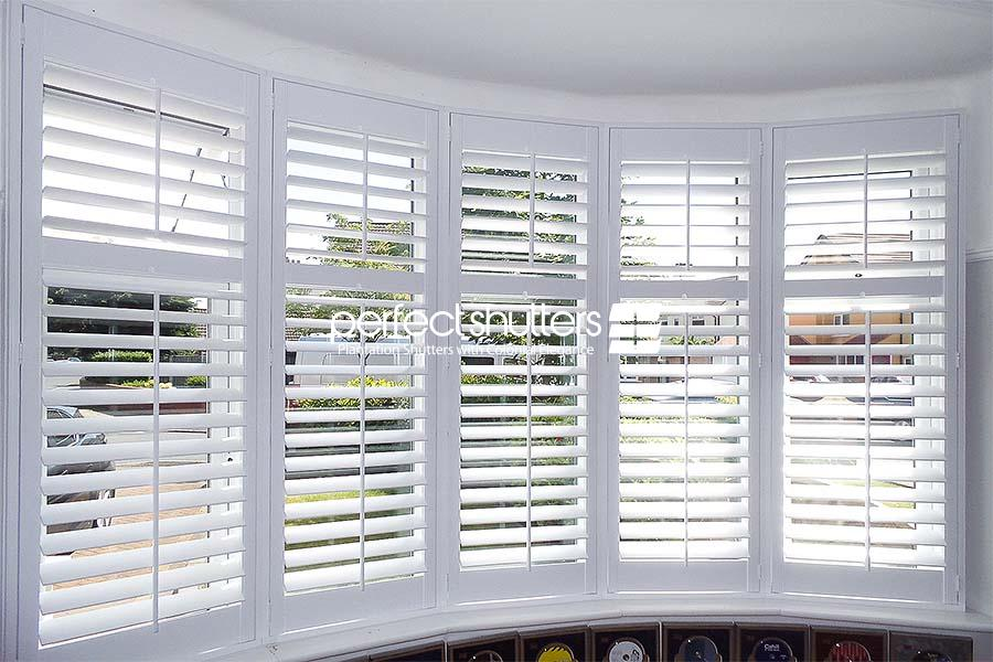 Open white bay window shutters