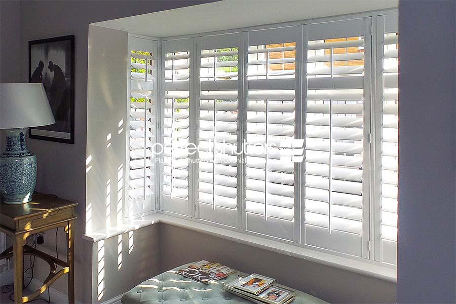 Bay window shutters in bedroom