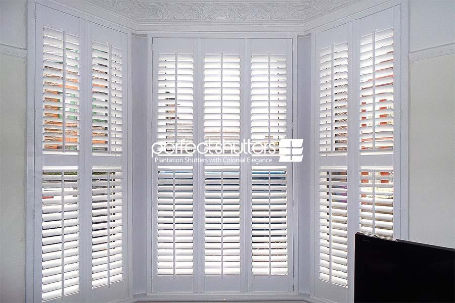 Bay window shutters - cloudy day