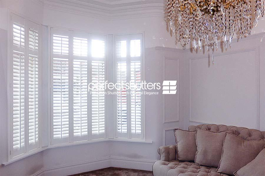 Open bay window shutters on a bright day