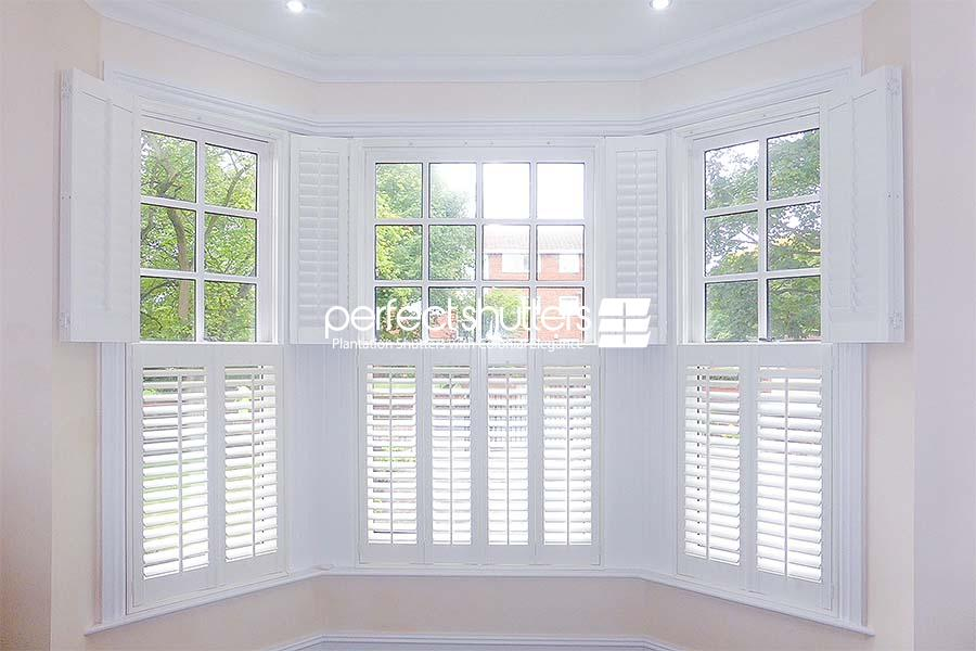 Two tier bay window shutters