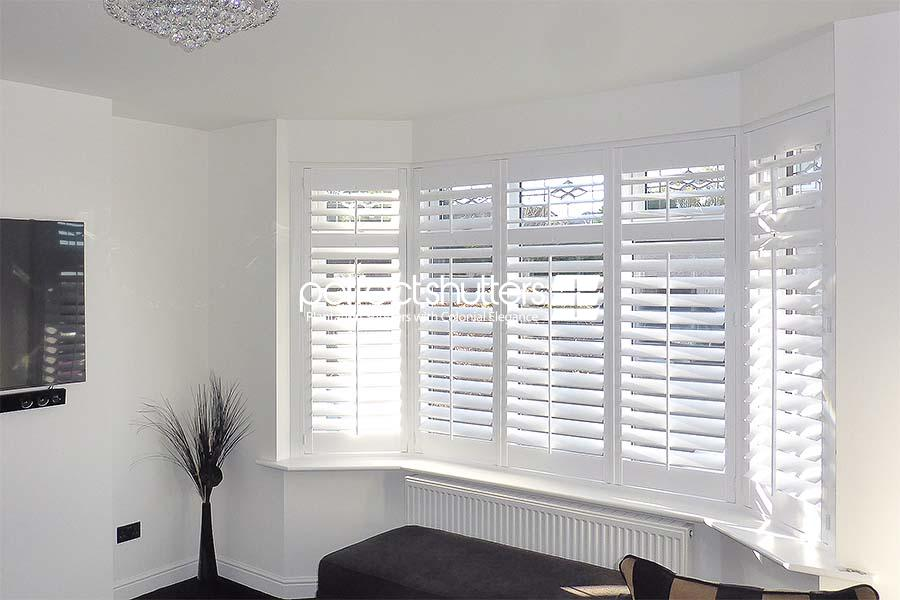 Bay window shutters letting light in