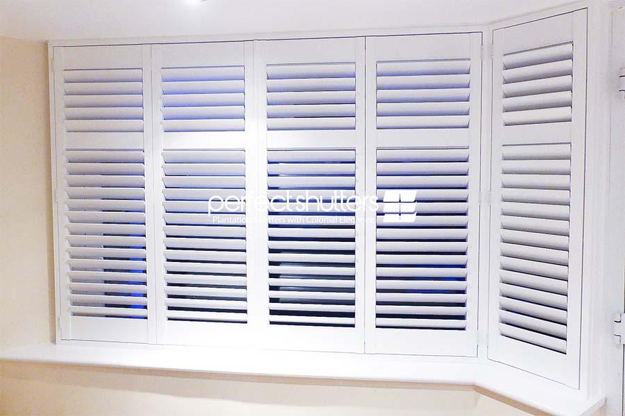 Bay window shutters at night