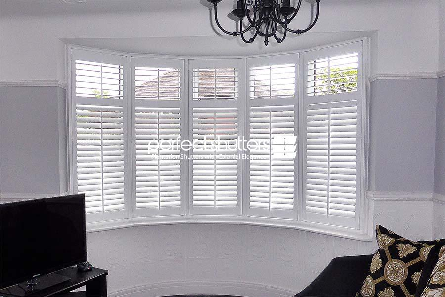 Beautiful white bay window shutters