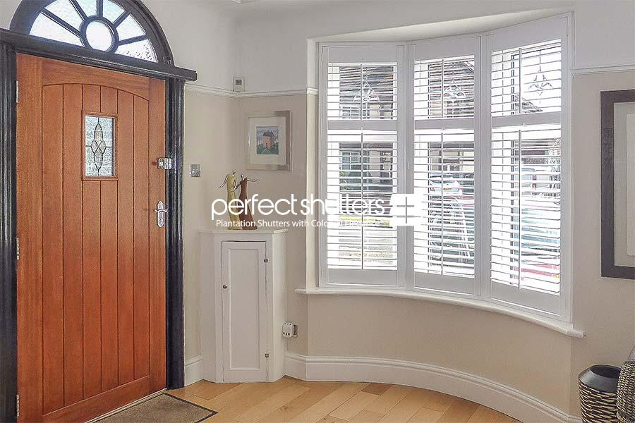 Bay window shutters by the entrance
