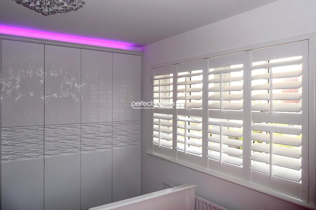 Wooden shutters in modern bedroom