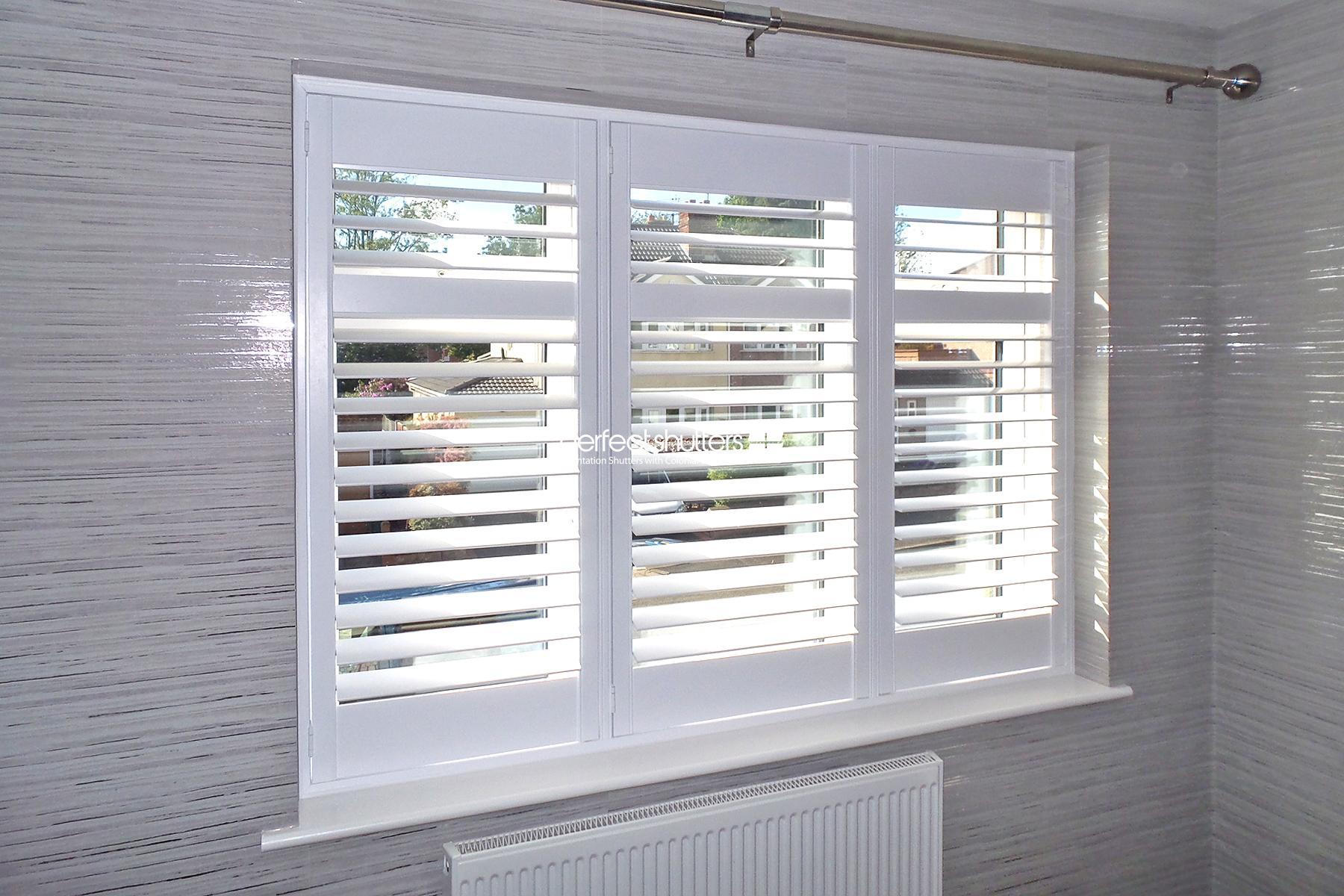 White bedroom window shutters