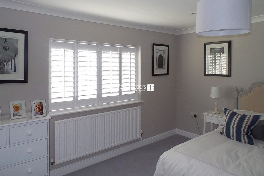 Plantation shutters in spacious bedroom