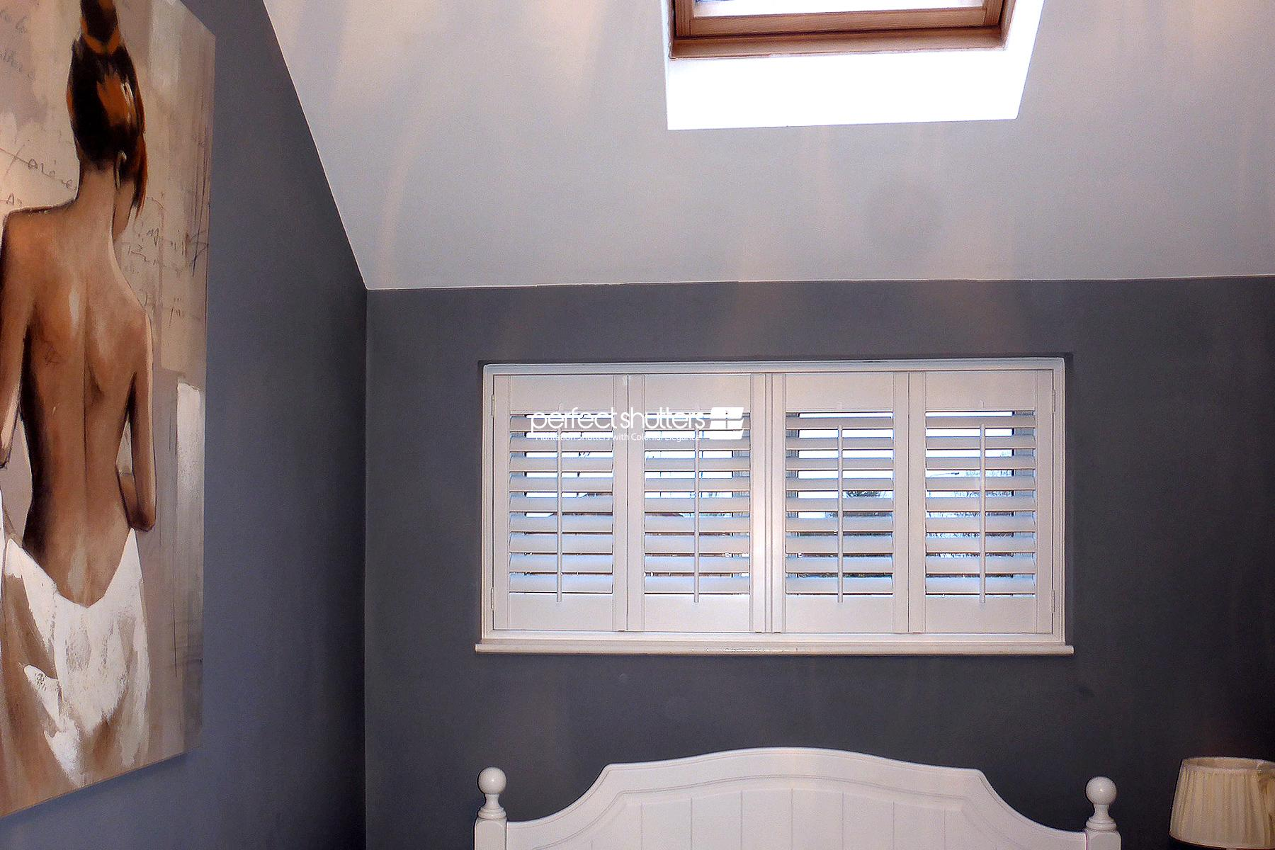 White shutters on small windows