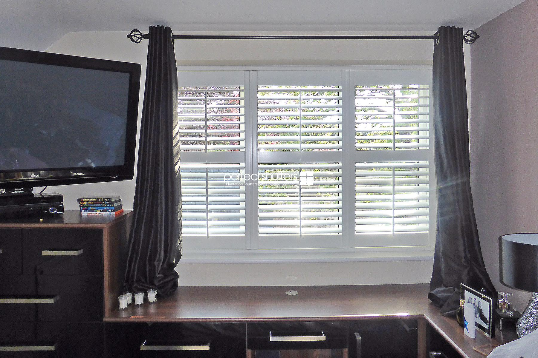 White shutters with curtains in bedroom