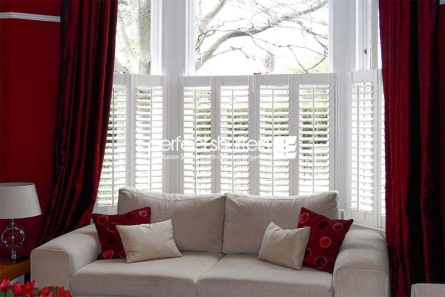 Cafe style shutters with red curtains