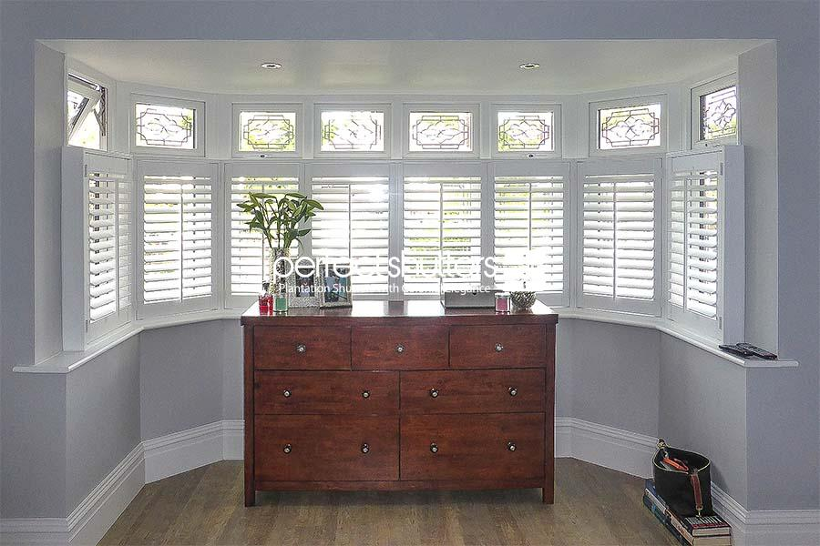 Wide cafe style shutters installation