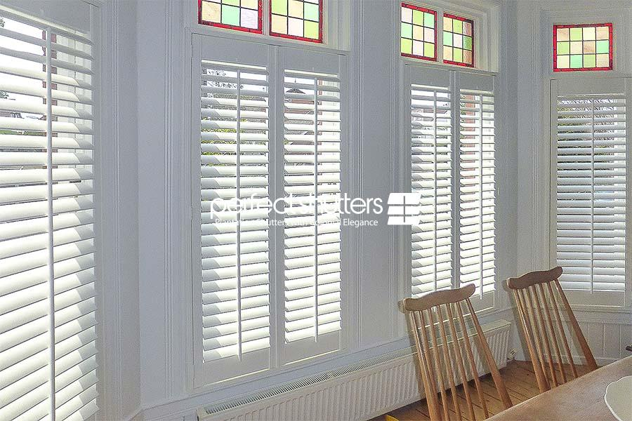 Cafe style shutters with small coloured windows on top