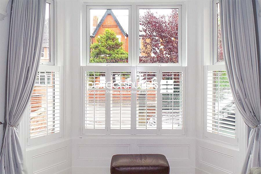Cafe style shutters with grey curtains