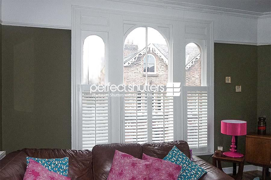 Cafe style shutters with arched windows