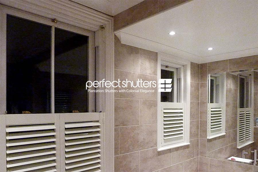 Cafe style shutters in bathroom