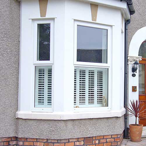 Image of a Bay Window Shutter saying that Plantation Shutters are a good investment and add value to your property.