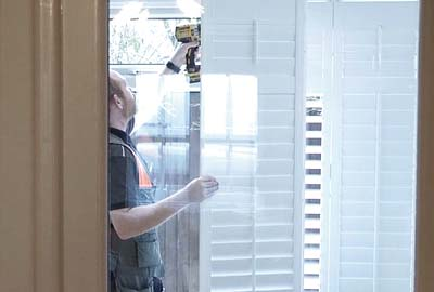 Image of fitter installing a perfect shutter