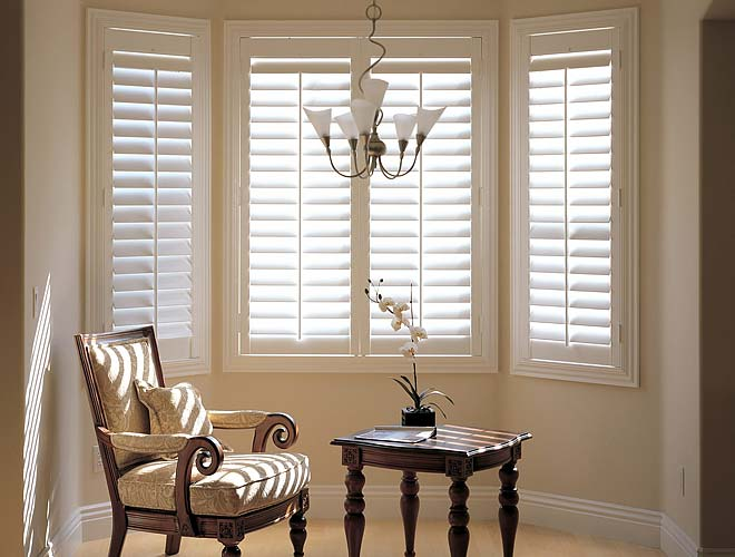 Image of a Bay Window Plantation Shutter in a living room, North West UK by Perfect Shutters