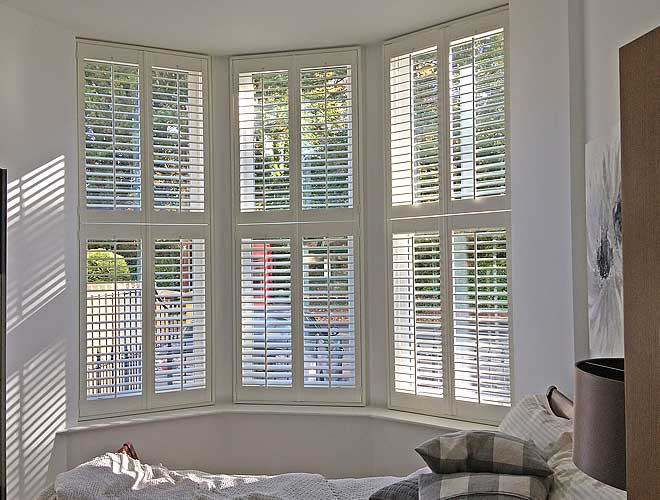 Image of a Bay Window Plantation Shutter in a bedroom, North West UK by Perfect Shutters