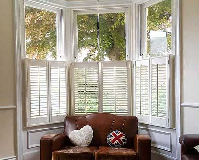 cafe-style shutters for bay windows